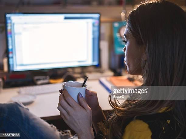 Woman taking a break from work in the office.