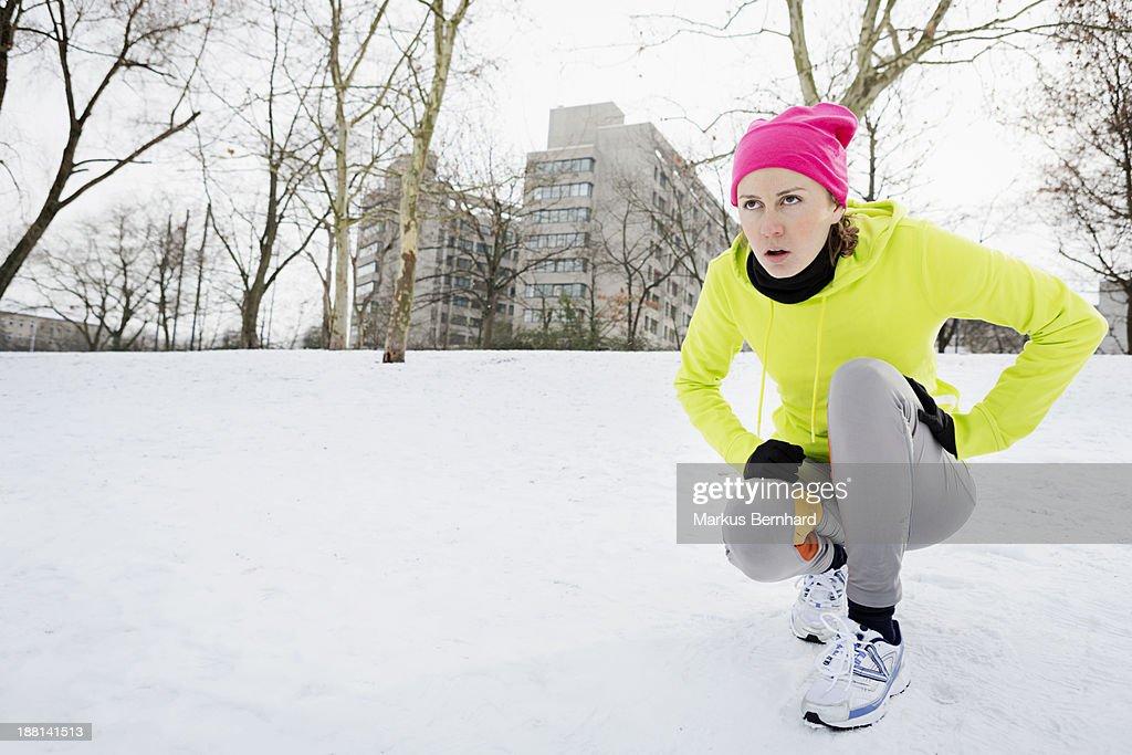 Woman taking a break while jogging : Stock Photo