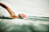Woman taking a breath during open water swim