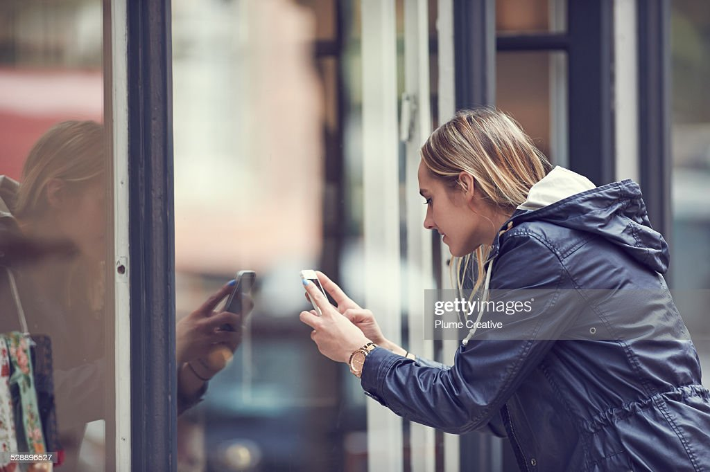Woman taking a photo with smartphone : Foto de stock