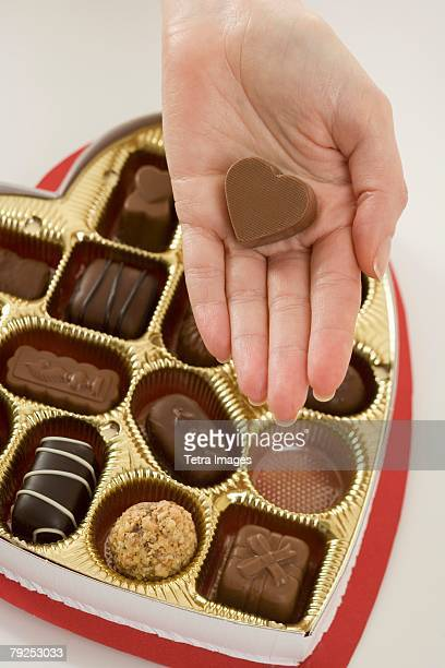 Woman taking a piece of candy from box