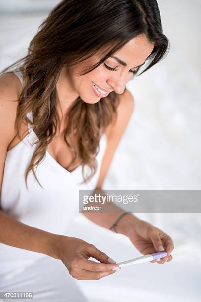 Woman taking a pregnancy test