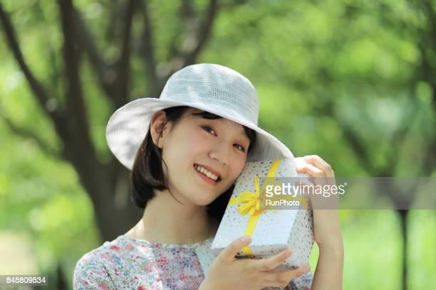 woman taking a present box