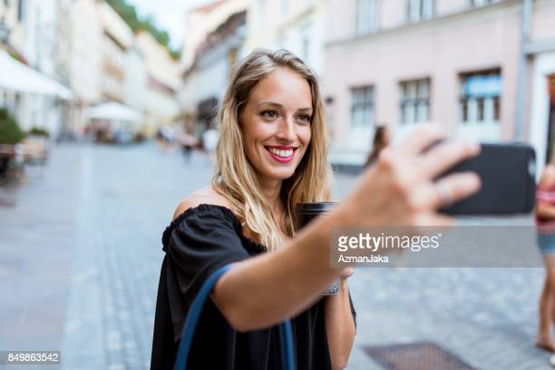 Woman taking a selfie in the city