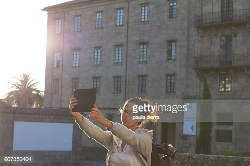Woman taking a selfie with digital tablet