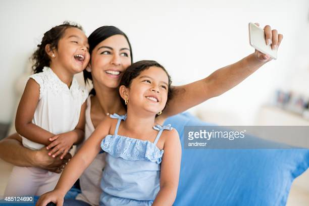 Woman taking a selfie with her daughters