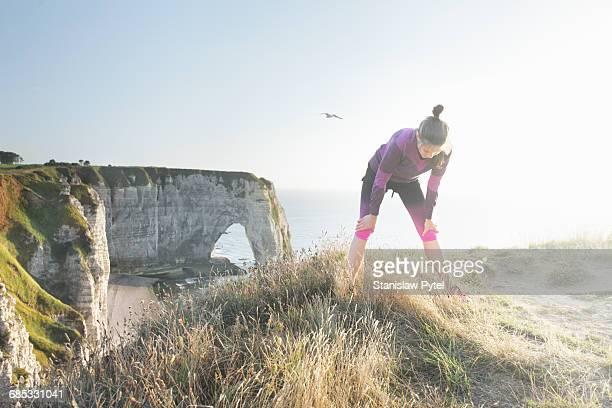 Woman taking break during running near sea