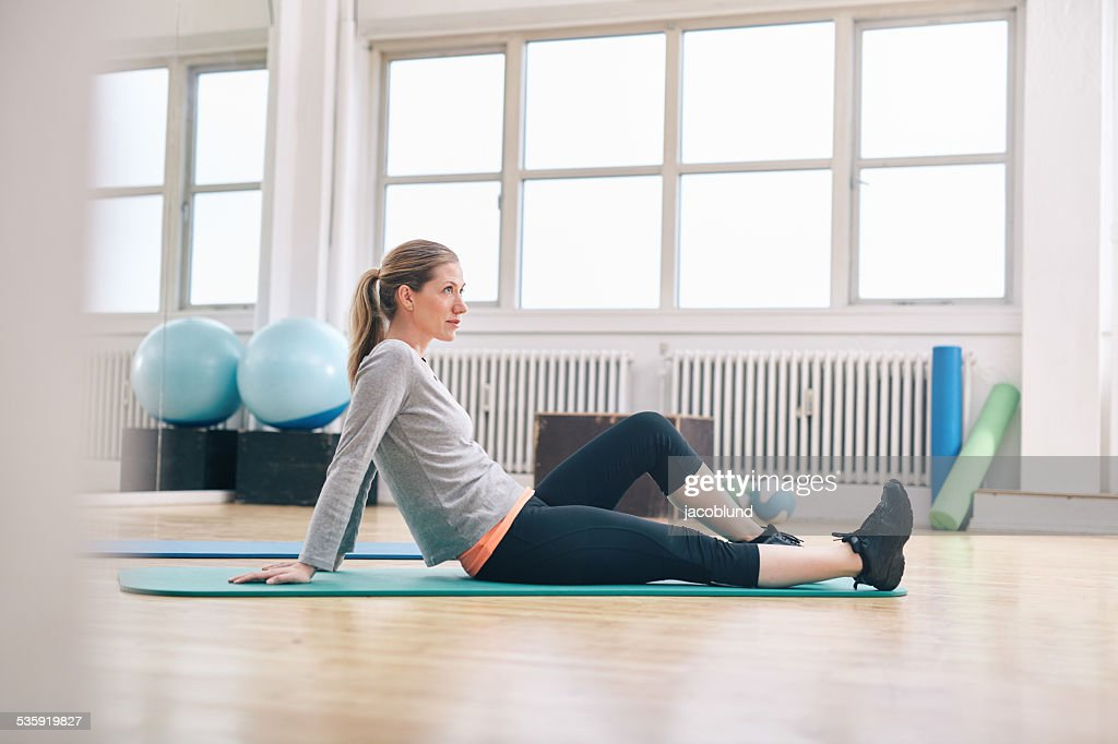 Woman taking break from her workout at gym : Stock Photo