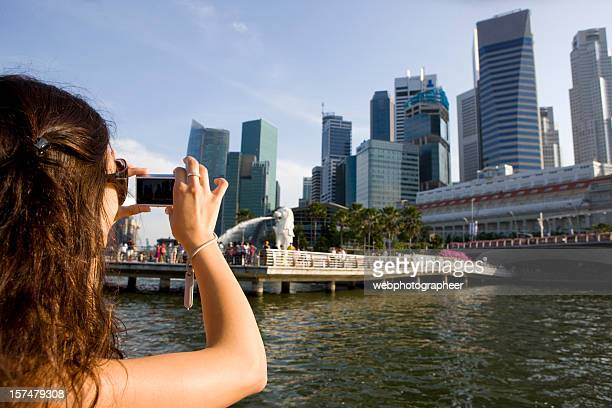 Woman taking digital photo of buildings