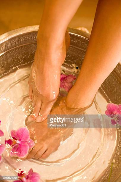 Woman taking footbath, low section, elevated view