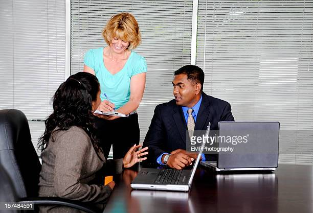 Woman Taking Notes with Diverse Business People