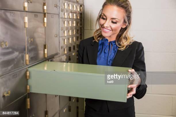 Woman taking out safety deposit box