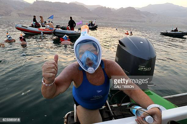 A woman taking part in a 17kilometre swim from Jordan to Israel across the Dead Sea organised by the EcoPeace charity aimed at raising awareness for...