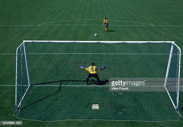 Woman taking penalty kick