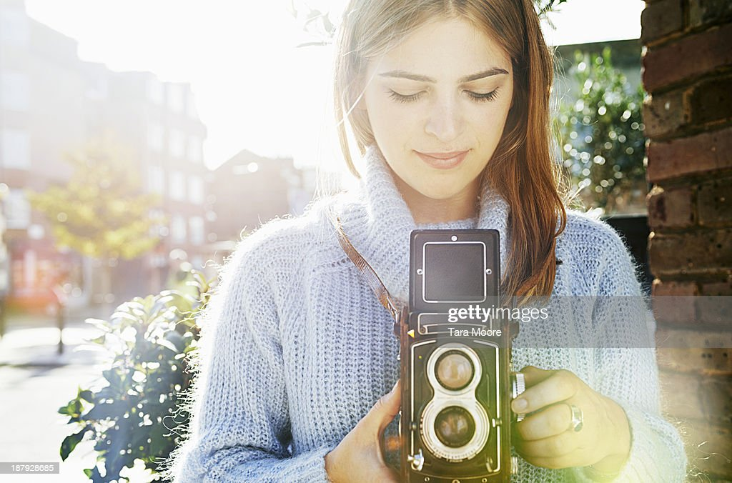 woman taking photo with vintage camera : Stock Photo