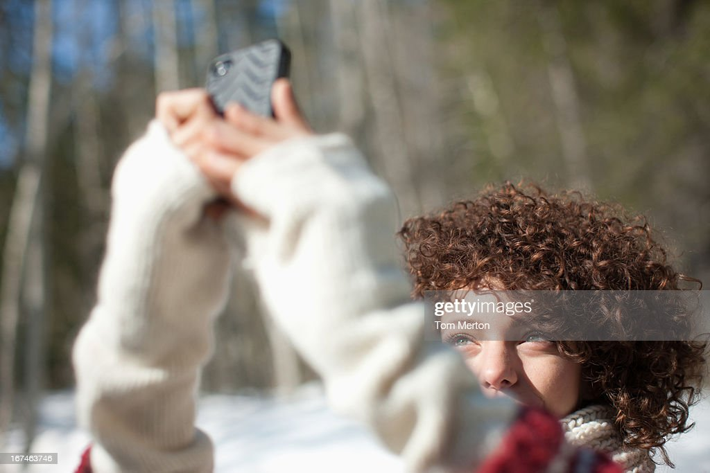 Woman taking photograph with cell phone : Stock Photo