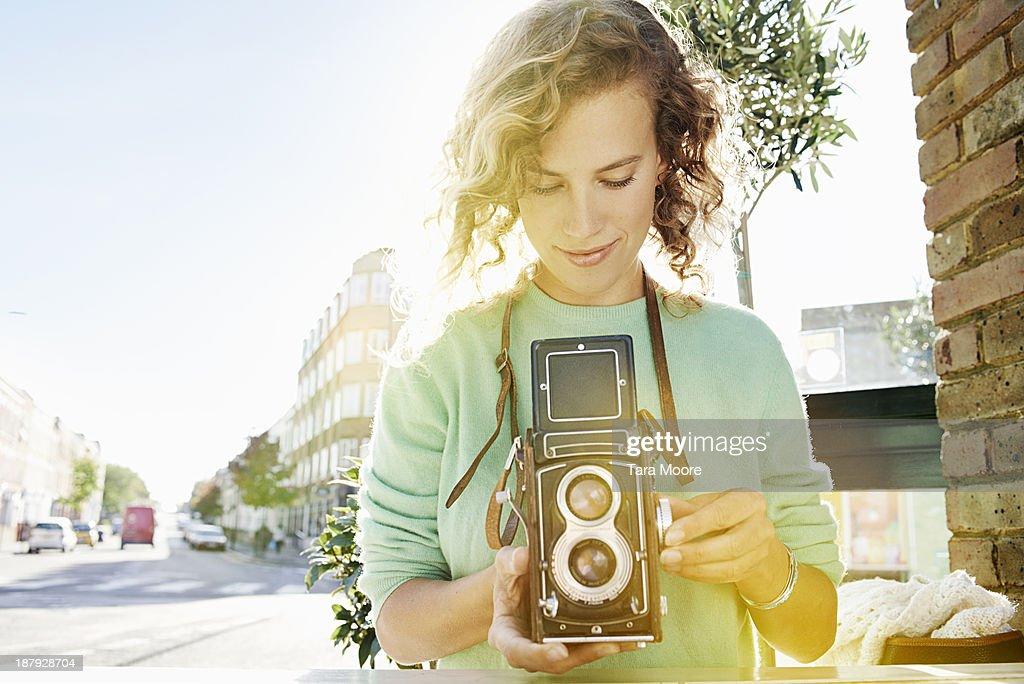 woman taking photograph with vintage camera : Stock Photo