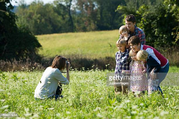 Woman taking picture of family