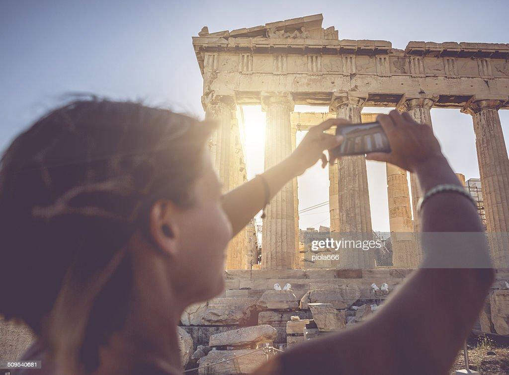 Woman taking picture to Parthenon