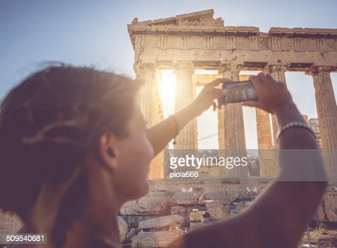 Woman taking picture to Parthenon