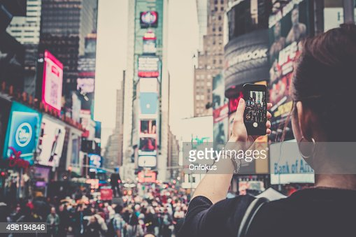 Woman Taking Picture With Mobile Phone at Times Squares, NYC