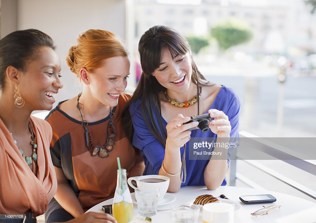 Woman taking pictures of food in cafe : Stock Photo
