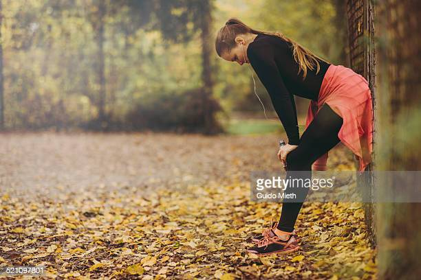 Woman taking rest after jogging.