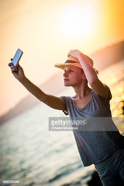 Woman taking self photo with smartphone