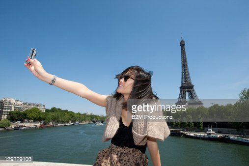 Woman Taking Self Portrait with Eiffel Tower : Stock Photo