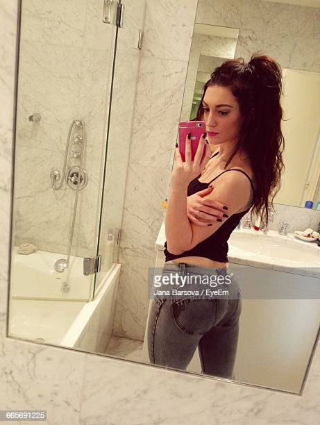 Woman Taking Selfie In Bathroom