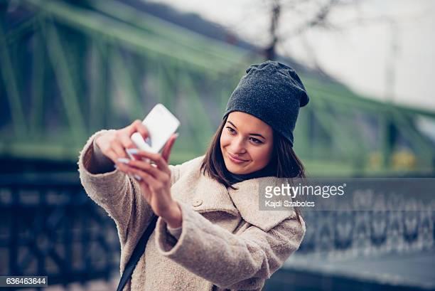 woman taking selfie in Budapest