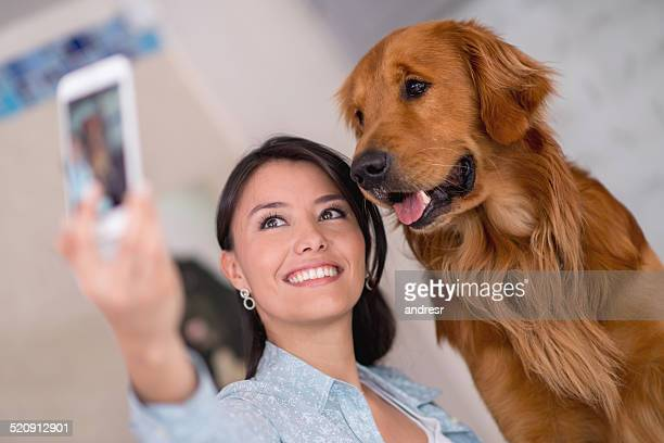 Woman taking selfie with a dog