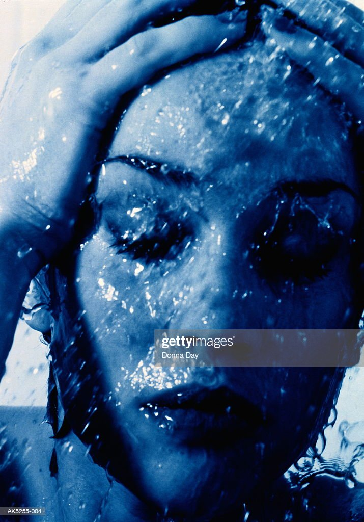 Woman taking shower, close-up : Stock Photo