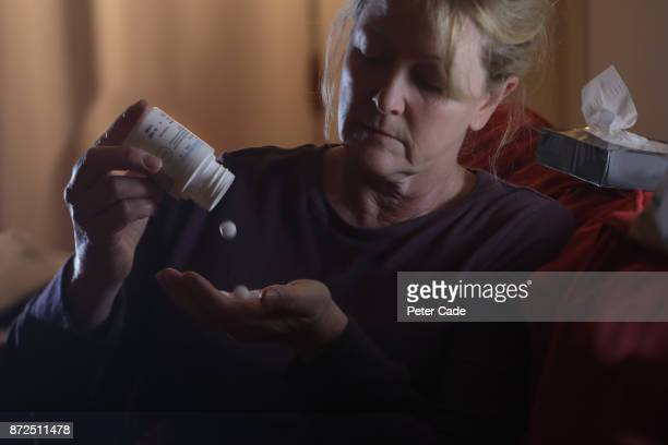 Woman taking tablet
