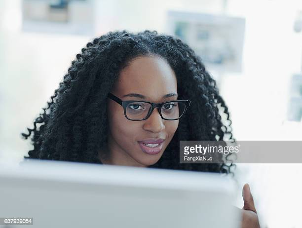 Woman talking about ideas behind computer in office