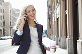 Woman talking on cell phone outdoors