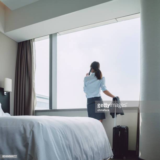 woman talking on cellphone in room