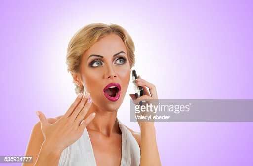 Woman talking on mobile phone : Stock Photo