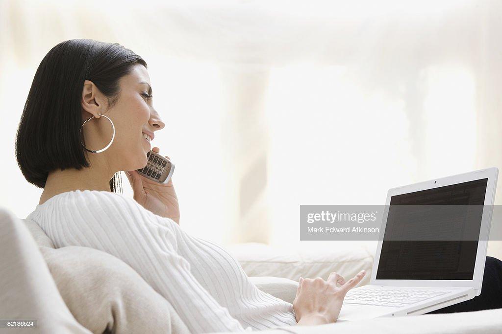 Woman talking on telephone : Stock Photo