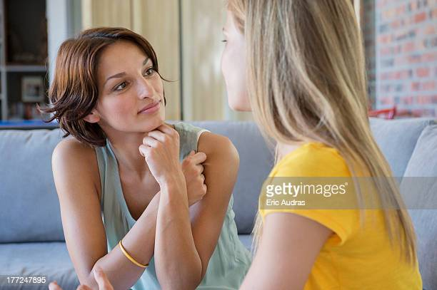 Woman talking to her daughter