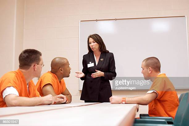 Woman talking to inmates