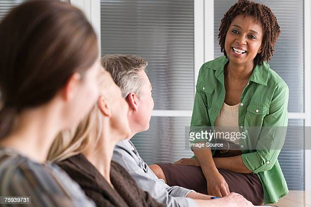 Woman talking to team