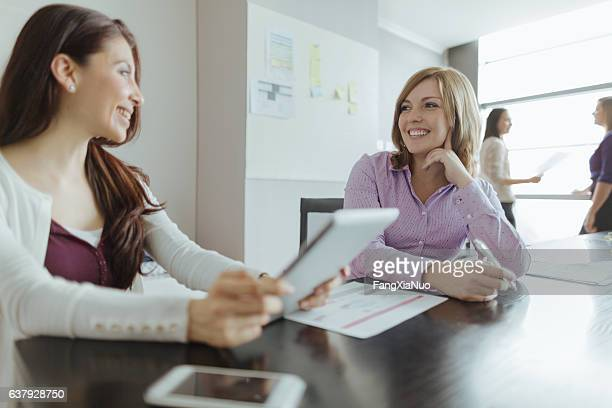 Woman talking together in design studio office