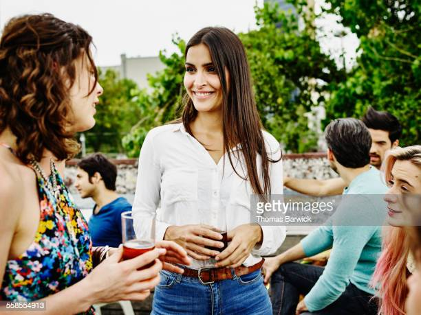 Woman talking with friends during party