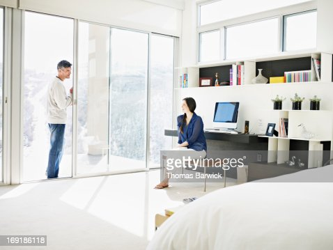 woman talking with husband in modern bedroom stock photo