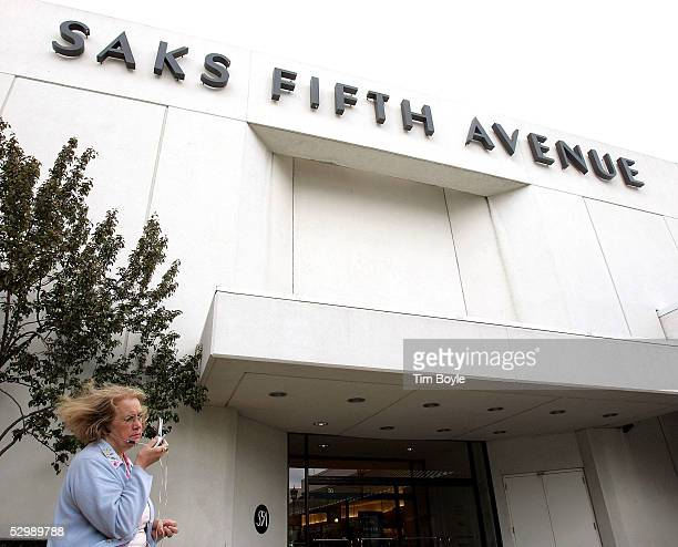 A woman talks on her cell phone outside the Saks Fifth Avenue department store at Old Orchard shopping center May 27 2005 in Skokie Illinois Saks...