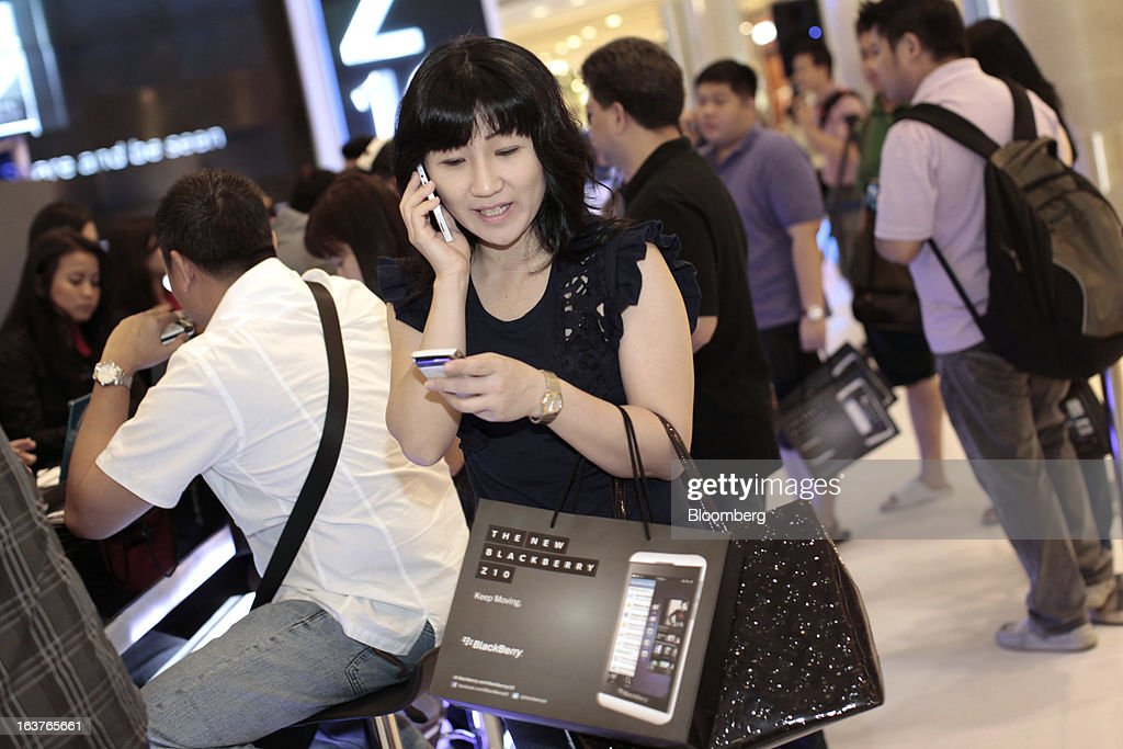 A woman talks on her newly purchased BlackBerry Z10 smartphone during the consumer launch of the device at the Central Park Mall in Jakarta, Indonesia, on Friday, March 15, 2013. BlackBerry, the Canadian smartphone maker that rolled out a new lineup in January, said one of its 'established partners' is buying 1 million BlackBerry 10 phones, the biggest order in the company's history. Photographer: Dimas Ardian/Bloomberg via Getty Images