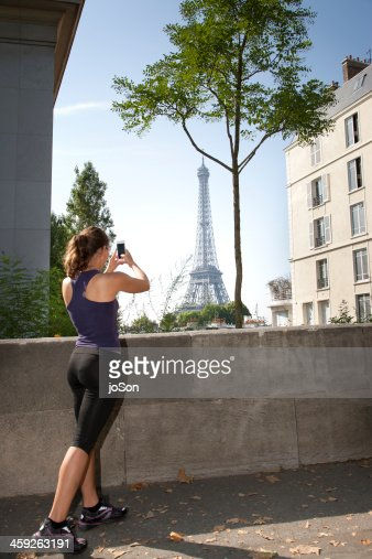 woman talks photo with moble phone, Exercising : Stock Photo