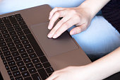 Woman tap touchpad. Concept freelancing, work on laptop.