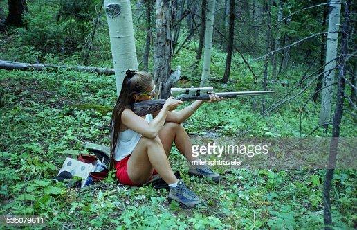 Woman target shooting in Colorado mountains